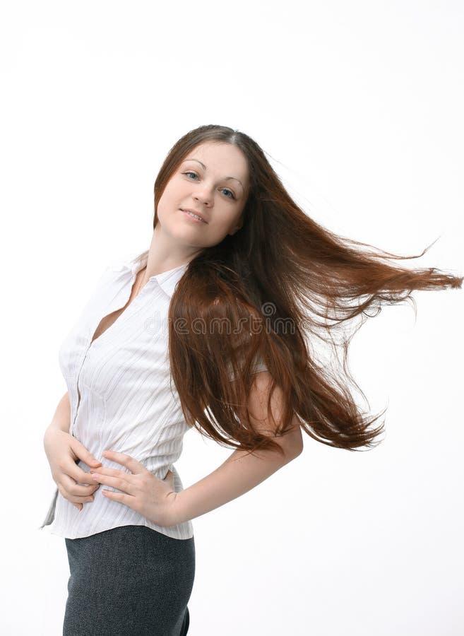 Mujer joven acertada que muestra el pulgar para arriba Aislado en blanco foto de archivo libre de regalías