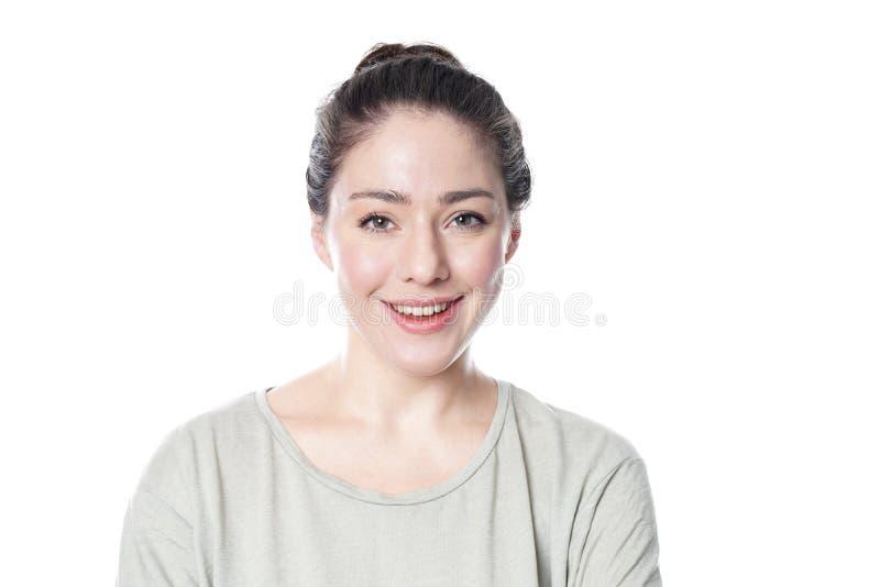 Mujer joven alegre en su sonrisa 20s fotografía de archivo libre de regalías