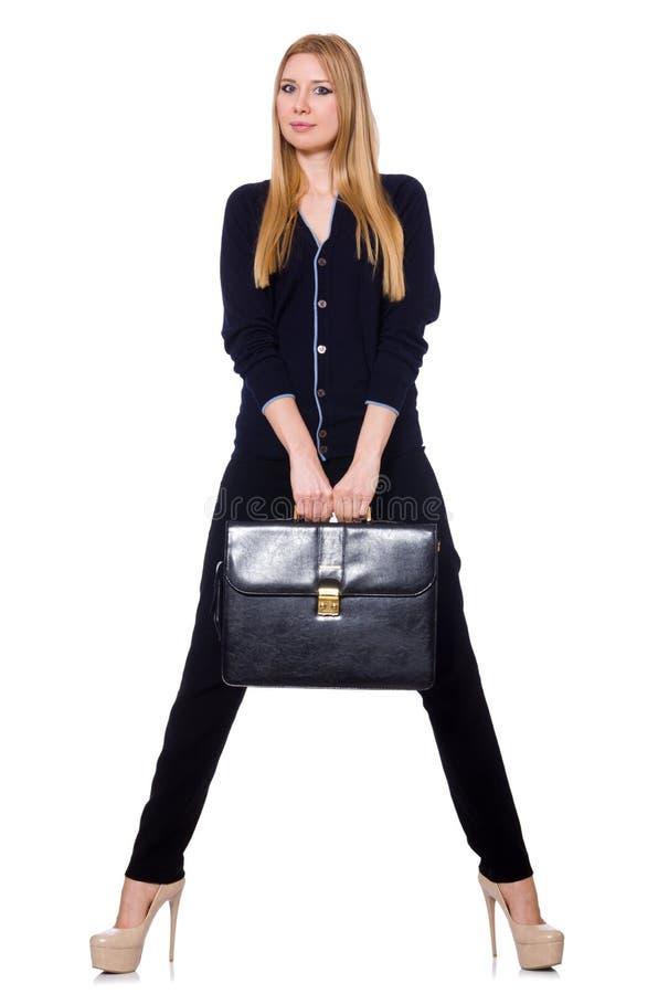 Mujer joven alta en ropa negra con el bolso fotografía de archivo
