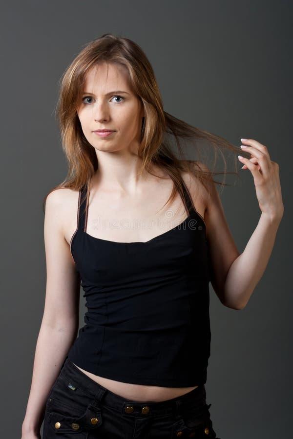 Mujer joven atractiva imagenes de archivo