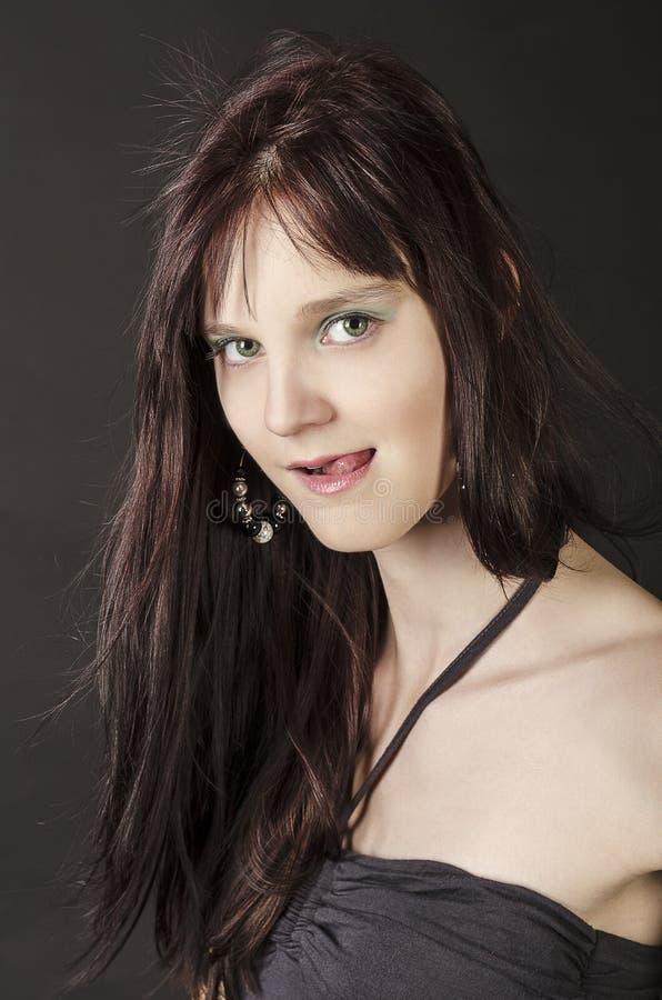 Mujer joven atractiva imagen de archivo