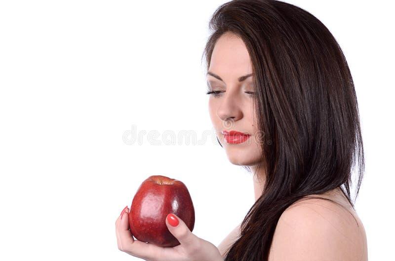 Mujer joven atractiva con la manzana fotografía de archivo