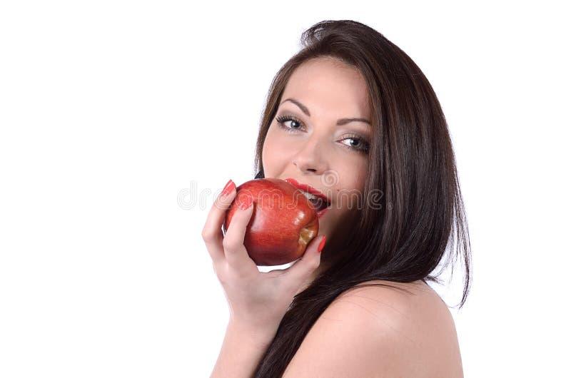 Mujer joven atractiva con la manzana foto de archivo