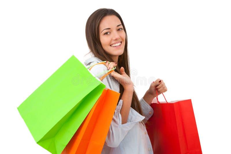 Mujer joven atractiva con los bolsos de compras fotografía de archivo