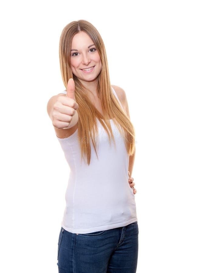 Mujer joven atractiva que muestra los pulgares para arriba imagenes de archivo