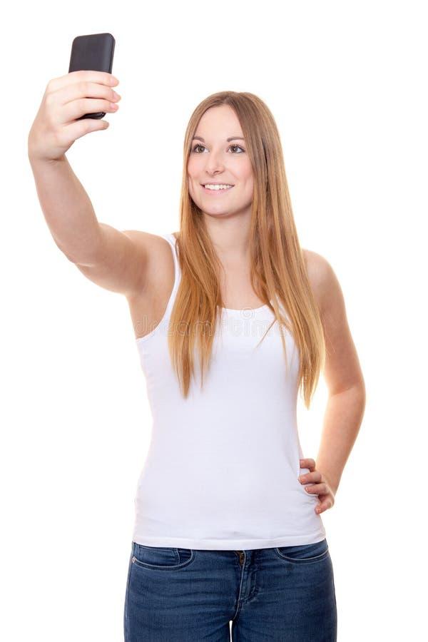 Mujer joven atractiva que toma un selfie foto de archivo libre de regalías