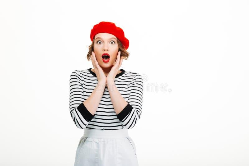 Mujer joven chocada que mira la cámara fotografía de archivo libre de regalías