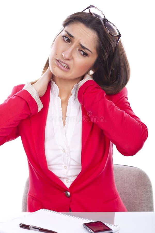 Mujer joven con dolor de cuello fotos de archivo