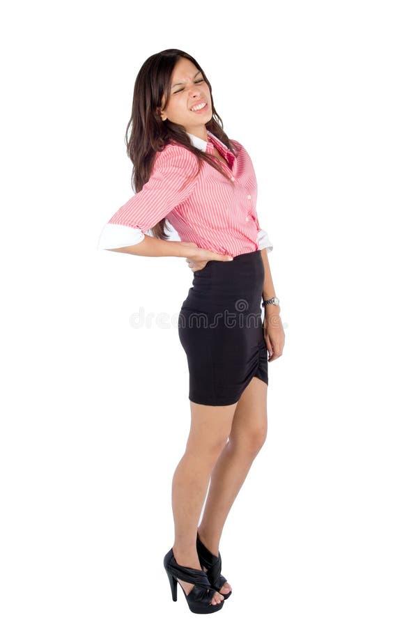 Mujer joven con dolor de espalda. fotografía de archivo