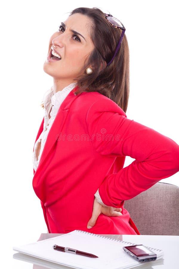 Mujer joven con dolor de espalda imagenes de archivo
