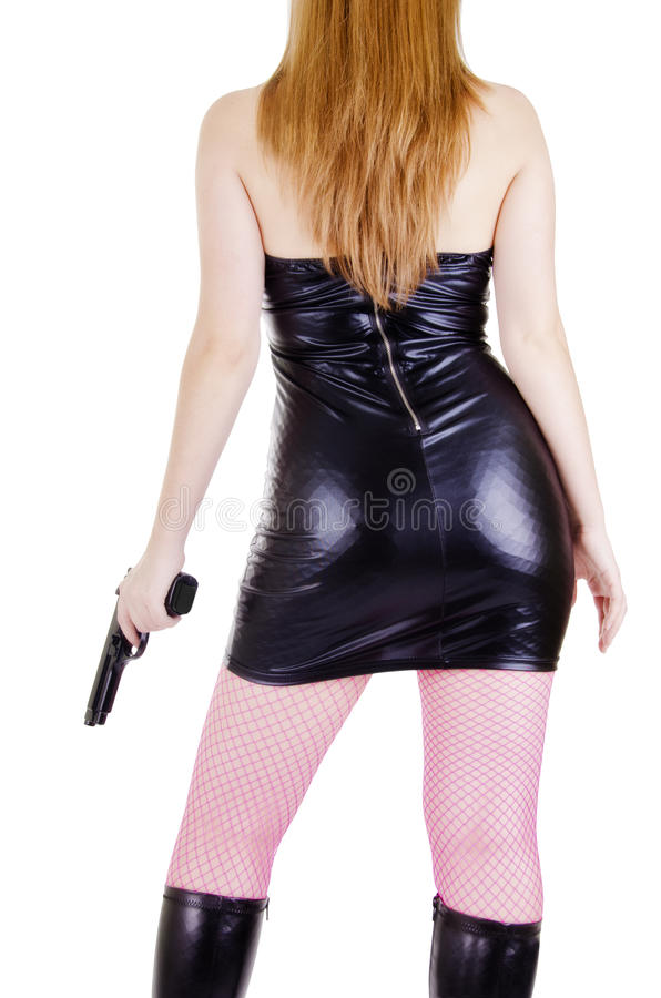 Mujer joven con el arma imagenes de archivo