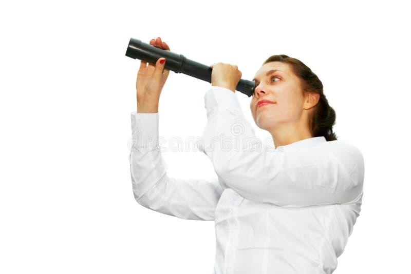 Mujer joven con el telescopio imagenes de archivo