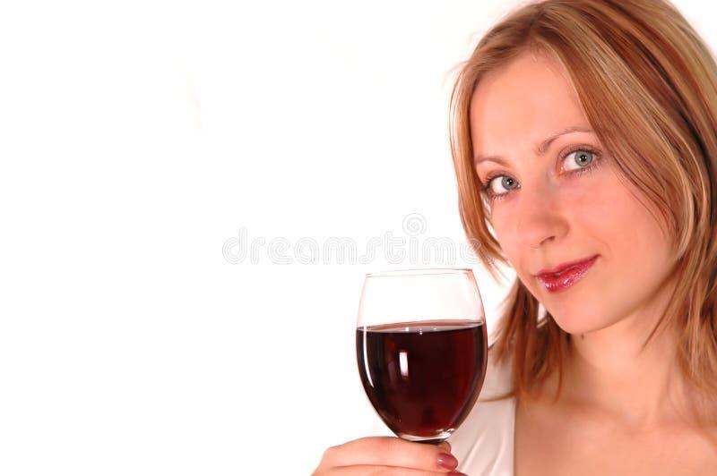 Mujer joven con el vidrio de vino fotografía de archivo libre de regalías