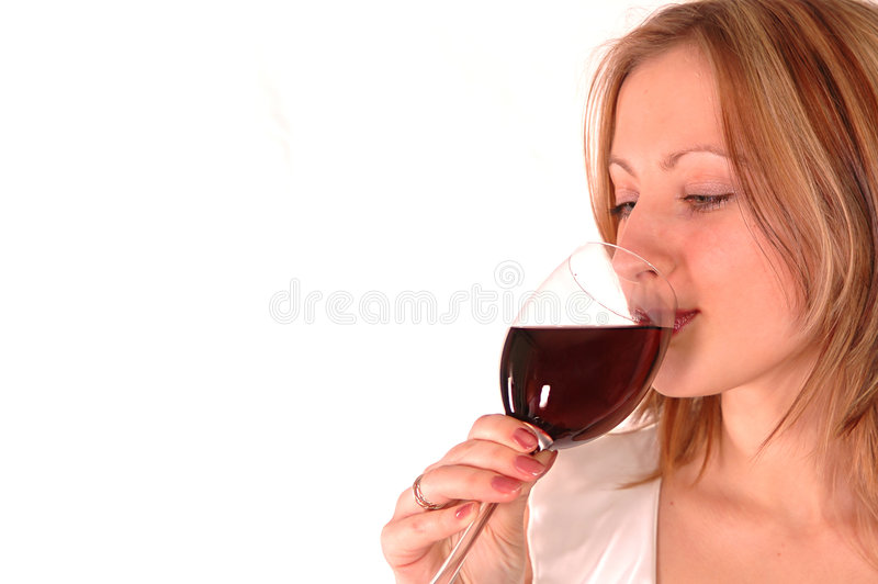 Mujer joven con el vidrio de vino fotos de archivo libres de regalías