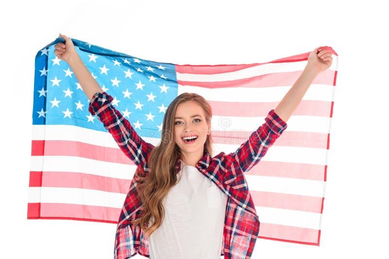 Mujer joven con la bandera americana fotos de archivo libres de regalías