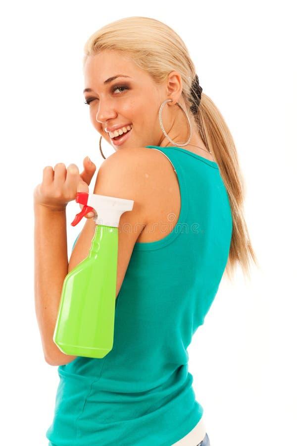 Mujer joven con la botella del espray fotografía de archivo libre de regalías
