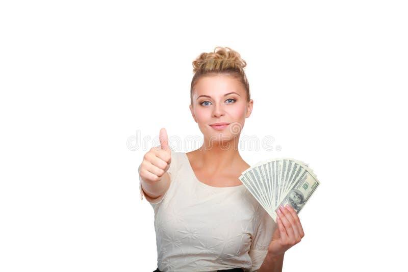 Mujer joven con las notas del dólar en su mano Aislado en el fondo blanco imagen de archivo