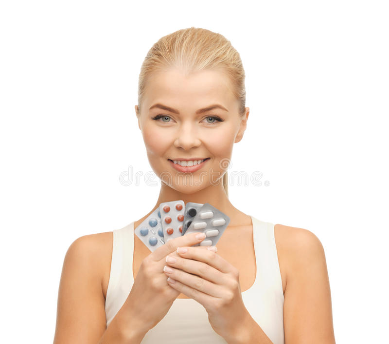 Mujer joven con las píldoras imágenes de archivo libres de regalías