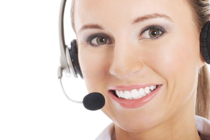 Mujer joven con los auriculares y el micrófono. imagen de archivo libre de regalías