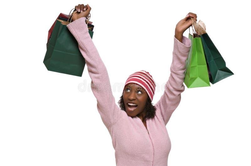 Mujer joven con los bolsos de compras fotos de archivo libres de regalías