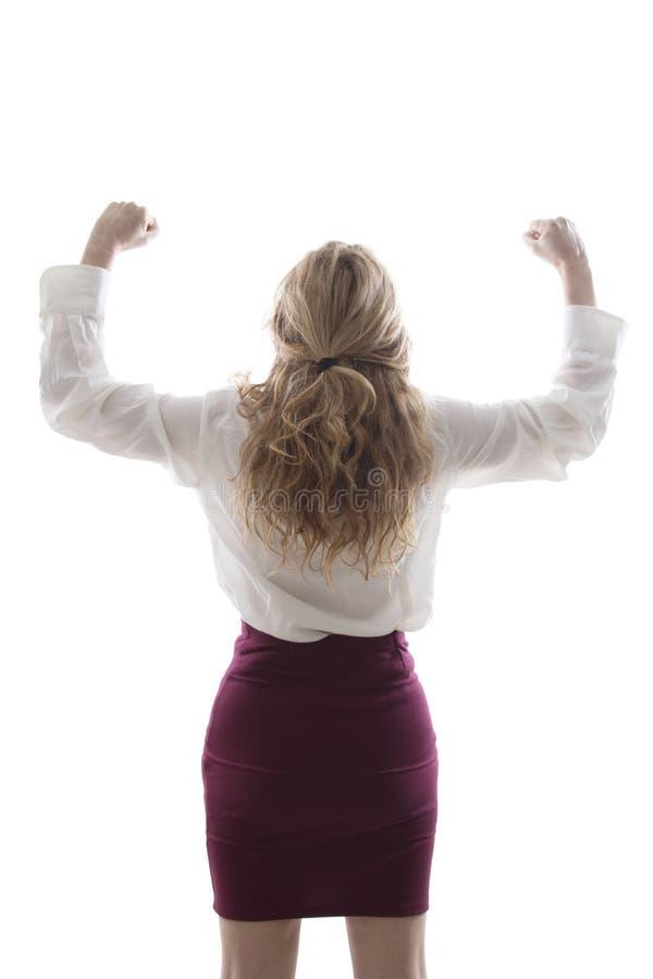 Mujer joven con los brazos levantados fotografía de archivo
