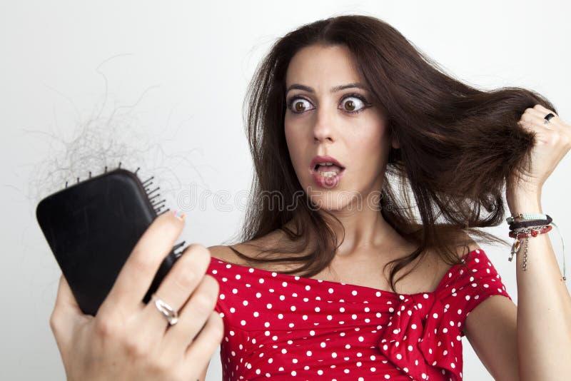 Mujer joven con mirada preocupante fotografía de archivo libre de regalías