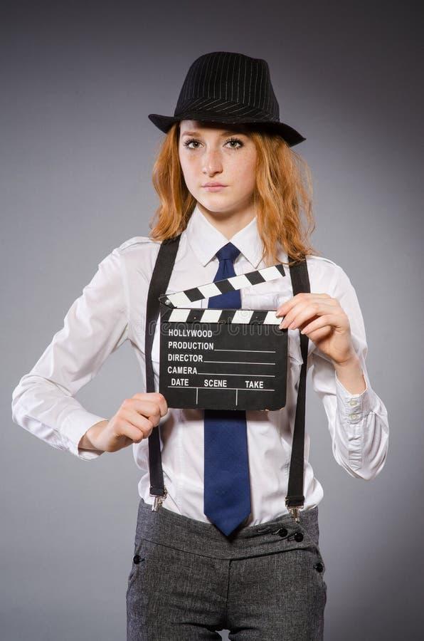 Download Mujer joven con película foto de archivo. Imagen de hollywood - 41918552