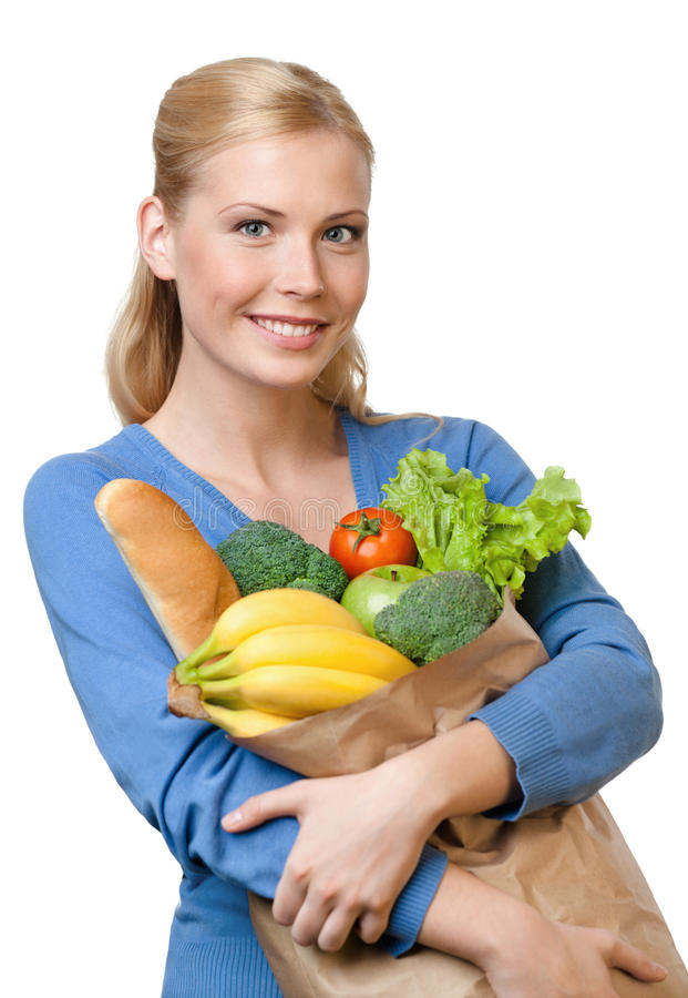 Mujer joven con un bolso lleno de alimento sano fotografía de archivo libre de regalías