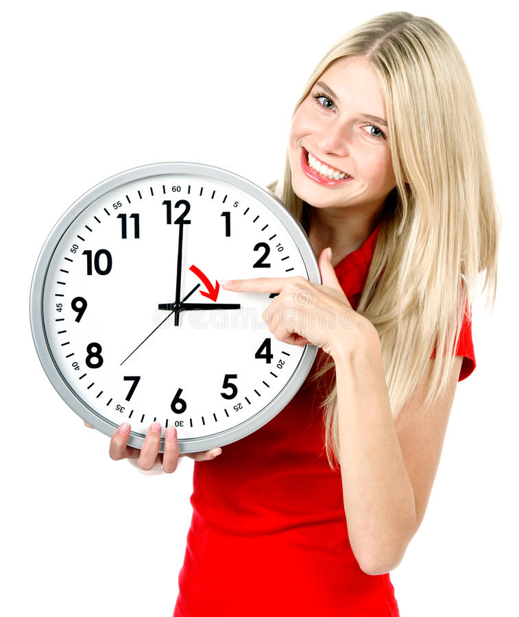 Mujer joven con un reloj Concepto de la gestión de tiempo imágenes de archivo libres de regalías