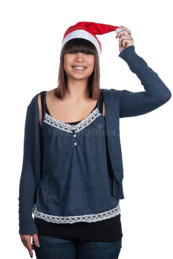 Mujer joven con un sombrero de la Navidad imagenes de archivo