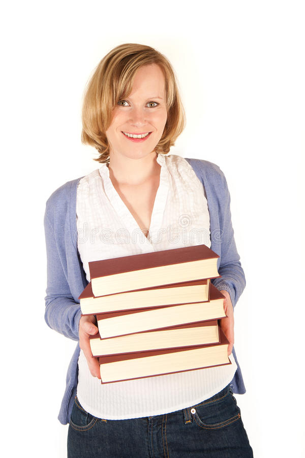 Mujer joven con una pila de libros fotografía de archivo libre de regalías
