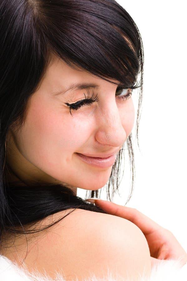 Mujer joven coqueta que guiña en usted foto de archivo libre de regalías
