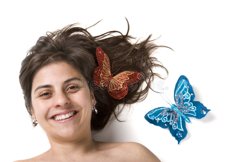 Mujer joven de Beautifull que sonríe con los butterflys imagen de archivo libre de regalías
