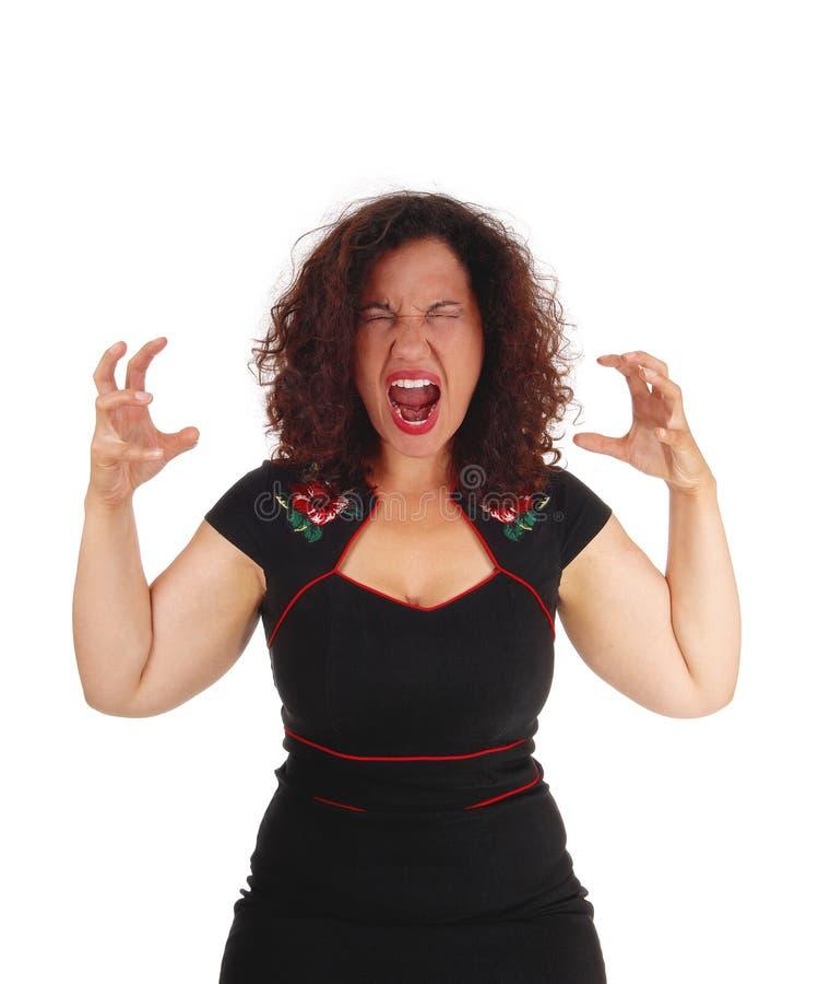 Mujer joven de griterío foto de archivo