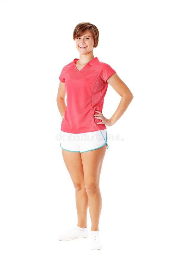 Mujer joven de la aptitud en la camisa roja aislada en blanco fotografía de archivo