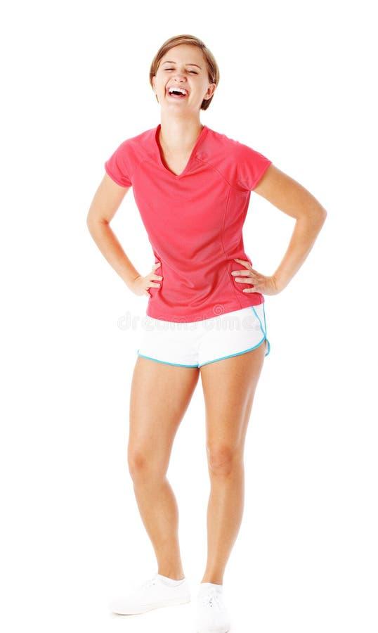 Mujer joven de la aptitud en la camisa roja aislada en blanco fotografía de archivo libre de regalías