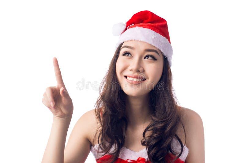 Mujer joven de santa del asiático que señala encima de usar el dedo índice, aislado fotos de archivo libres de regalías