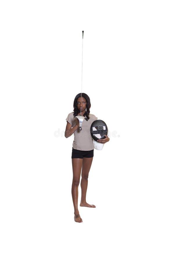 Mujer joven del afroamericano con el estoque y la máscara imagenes de archivo