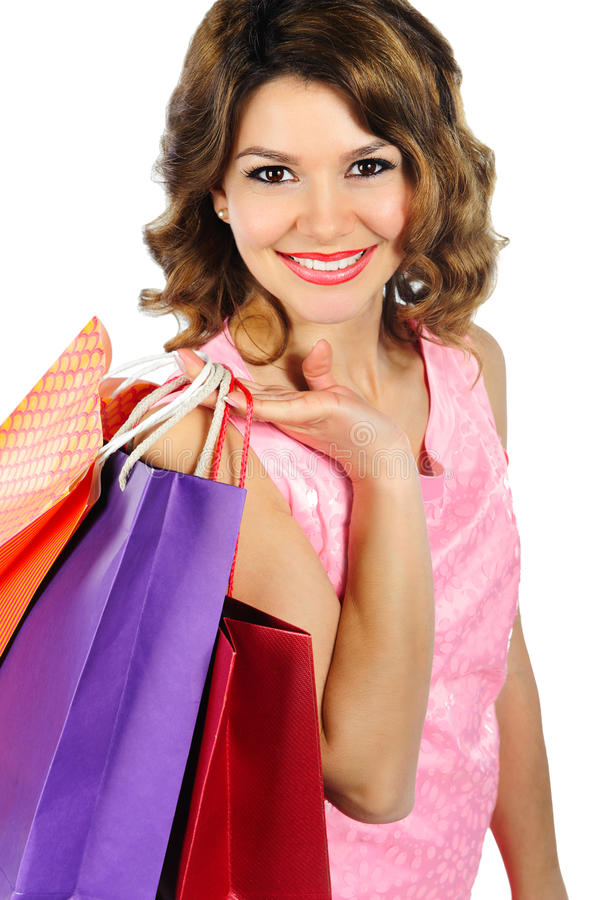 Mujer joven del beautifil con los bolsos de compras coloridos aislados en wh fotografía de archivo libre de regalías