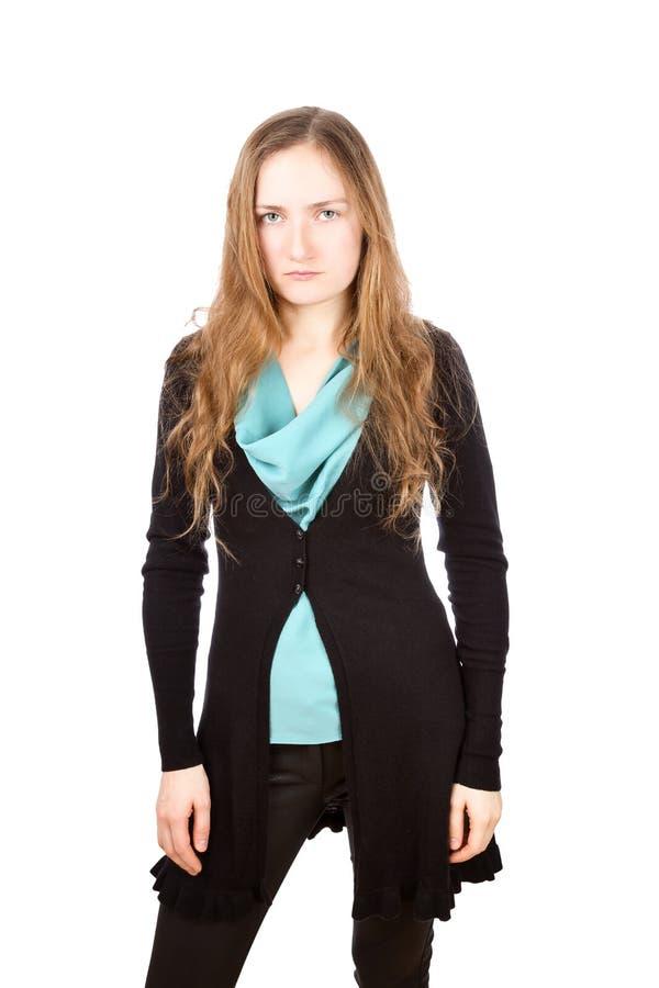 Mujer joven descontentada con mirada cansada foto de archivo