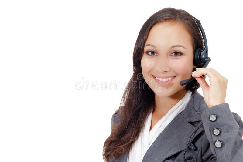 Mujer joven dulce que lleva auriculares fotografía de archivo libre de regalías