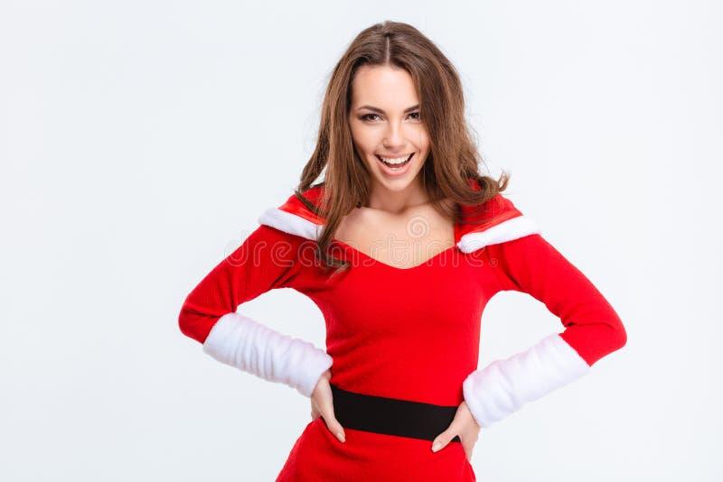 Mujer joven emocionada feliz en el traje de Papá Noel imágenes de archivo libres de regalías