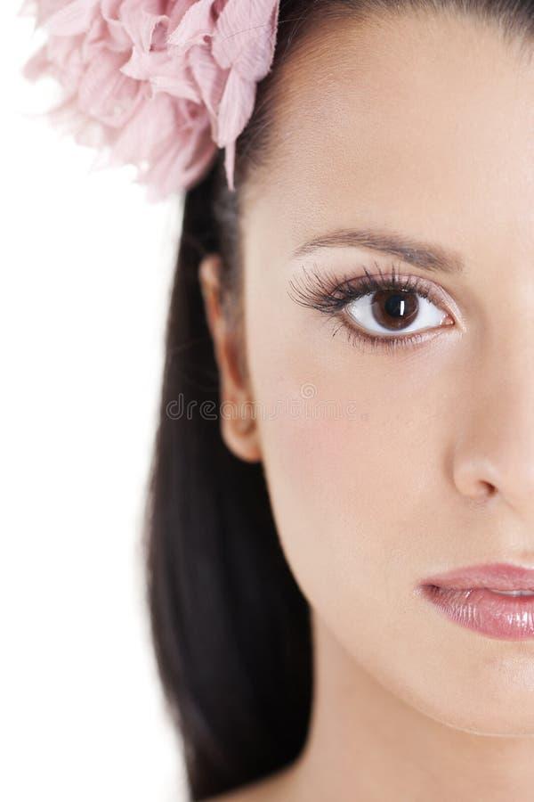 Mujer joven en alineada rosada fotografía de archivo libre de regalías