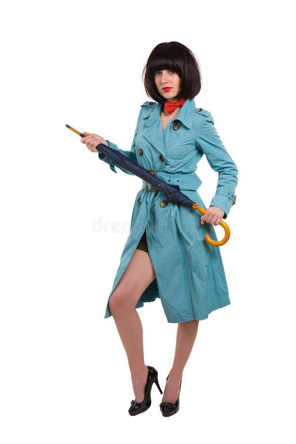 Mujer joven en capa azul fotos de archivo