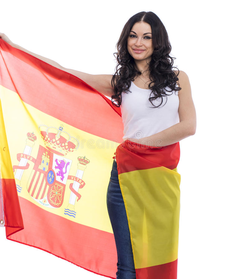 Mujer joven en el fondo de la bandera española imagen de archivo libre de regalías