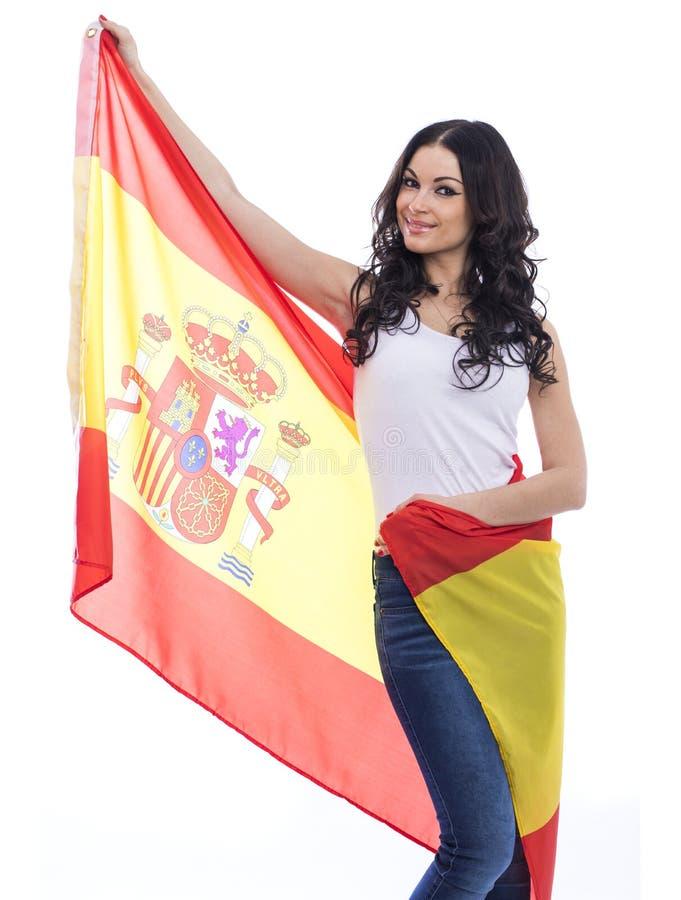 Mujer joven en el fondo de la bandera española imágenes de archivo libres de regalías