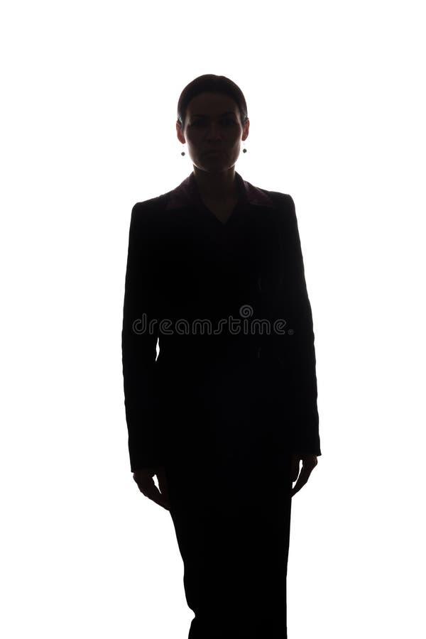 Mujer joven en el traje, vista delantera - silueta fotos de archivo libres de regalías