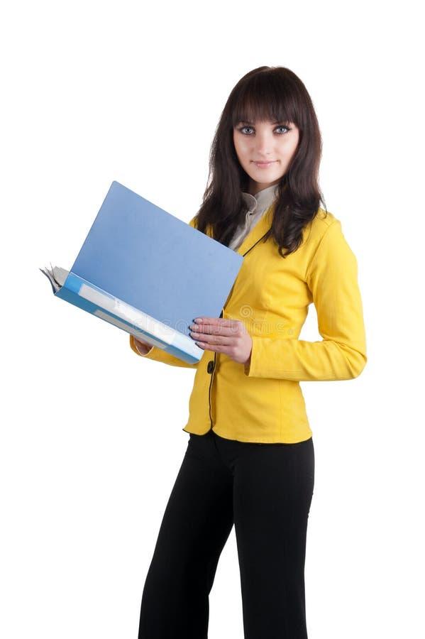 Mujer joven en juego amarillo con la carpeta de la oficina. fotos de archivo libres de regalías