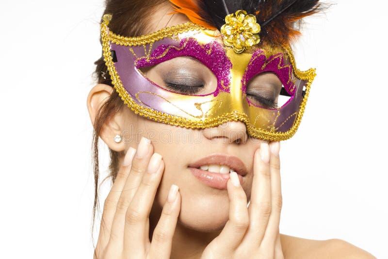 Mujer joven en la máscara veneciana imágenes de archivo libres de regalías