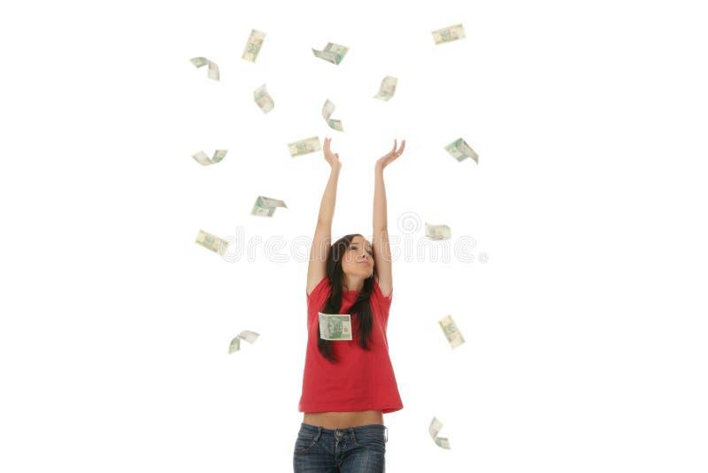 Mujer joven en lluvia polaca del dinero foto de archivo